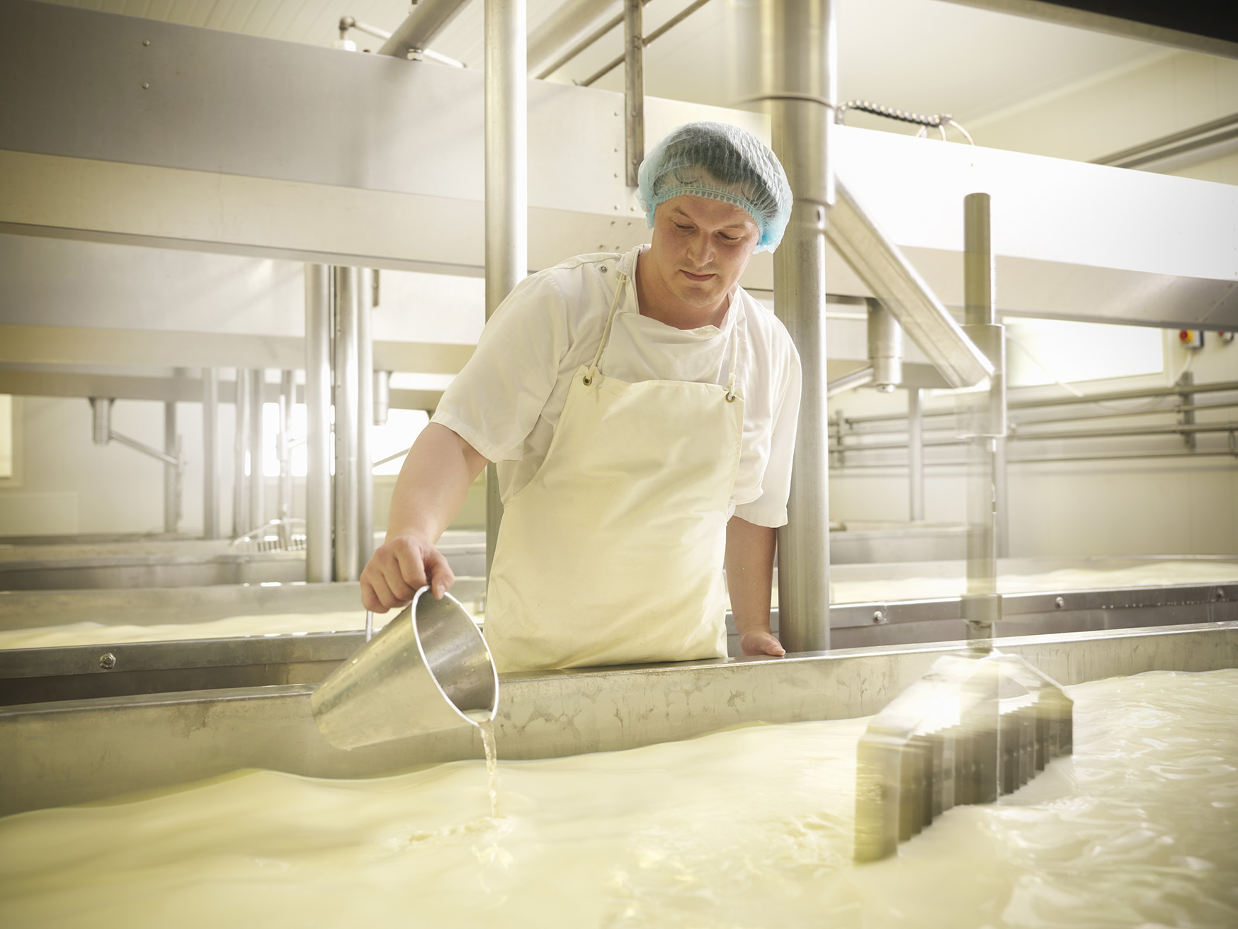 Man working with dairy products